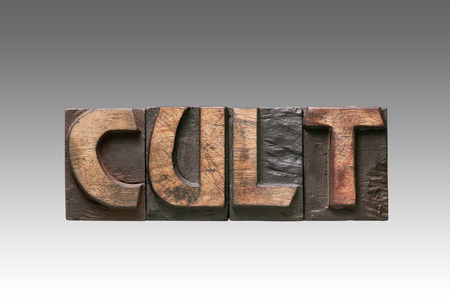 cult: cult word assembled from vintage wooden typography letters isolated on gradient background Stock Photo