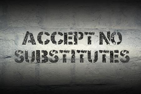 ersatz: accept no substitutes stencil print on the grunge white brick wall