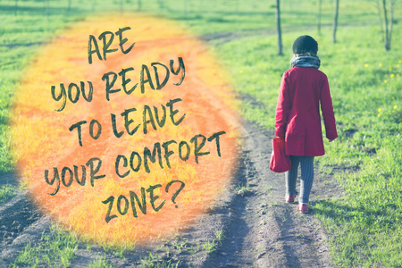 printed slogan about comfort zone leaving printed on image with girl in red coat going far away by dirty country road
