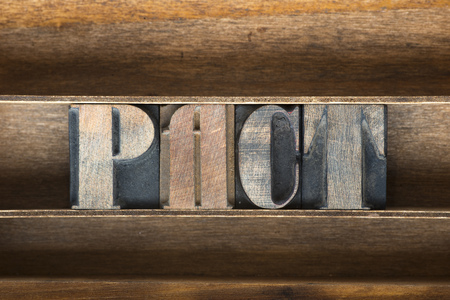 pacto: pact word made from vintage letterpress type on wooden tray