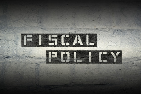fiscal: fiscal policy stencil print on the grunge white brick wall