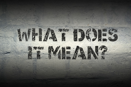 what does it mean question stencil print on the grunge white brick wall