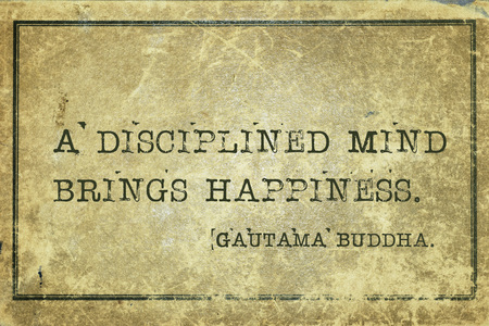 A disciplined mind brings happiness - famous quote of Gautama Buddha printed on grunge vintage cardboard Фото со стока