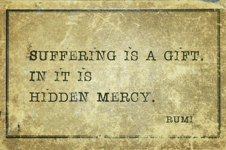 Suffering is a gift. In it is hidden mercy - famous ancient Greek comic playwright Aristophanes quote printed on grunge vintage cardboard