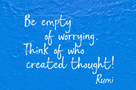 Be empty of worrying. Think of who created thought - ancient Persian poet and philosopher Rumi quote handwritten on blue wall