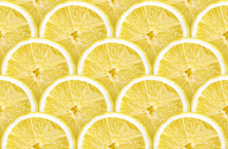 detailed background made from many lemon slices, seamless pattern Stock Photo