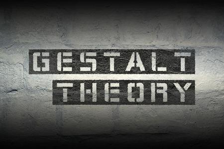 gestalt theory phrase stencil print on the grunge white brick wall 版權商用圖片