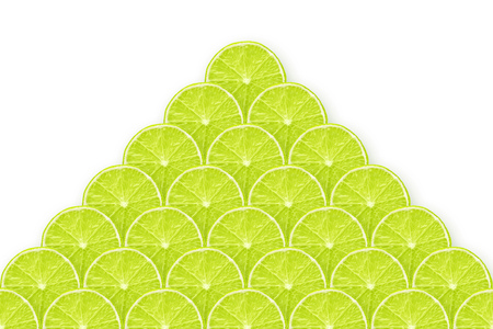 pyramid made from many fresh lime slices on white Stock Photo