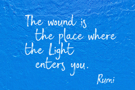 The wound is the place where the Light enters you - ancient Persian poet and philosopher Rumi quote handwritten on blue wall