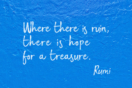 Where there is ruin, there is hope for a treasure - ancient Persian poet and philosopher Rumi quote handwritten on blue wall