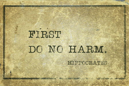 First do no harm - famous ancient Greek physician Hippocrates quote printed on grunge vintage cardboard Stok Fotoğraf