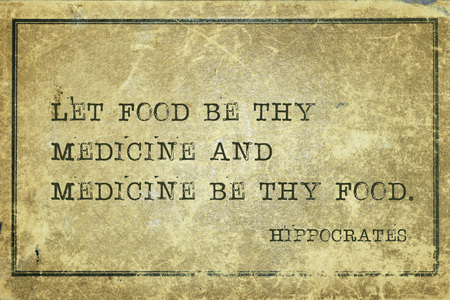 Let food be thy medicine and medicine be thy food - famous ancient Greek physician Hippocrates quote printed on grunge vintage cardboard