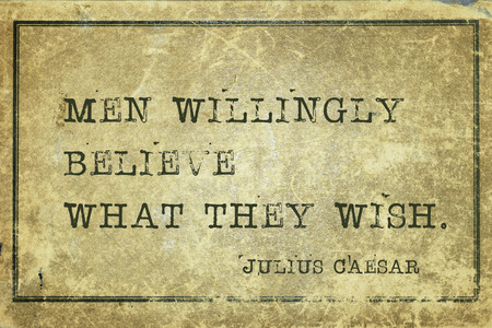 Men willingly believe what they wish - ancient Roman politician and general Julius Caesar quote printed on grunge vintage cardboard Stock Photo