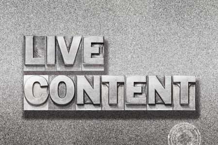 live content phrase made from vintage letterpress on metallic textured background