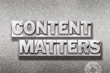 content matters phrase made from vintage letterpress on metallic textured background