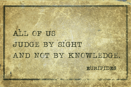 All of us judge by sight and not by knowledge - ancient Greek philosopher Euripides quote printed on grunge vintage cardboard Imagens