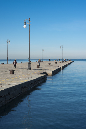 many people have walk at famous Audace Pier in Trieste city, Italy Stok Fotoğraf