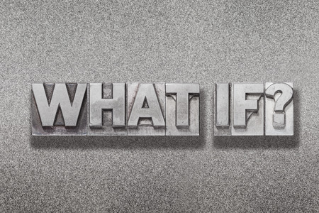 what if question made from vintage letterpress on metallic textured background