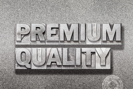 premium quality phrase made from vintage letterpress on metallic textured background