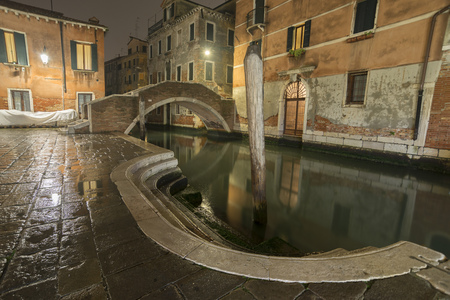 scenic night view to the Ruga Vecchia bridge in Venice, Italy