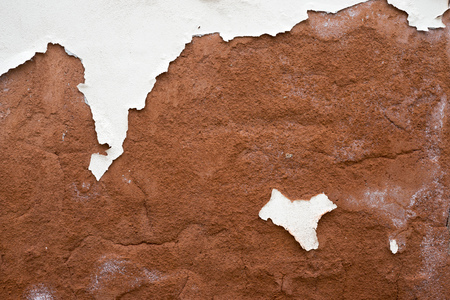 red plaster wall background with peeled off white paint   Banco de Imagens