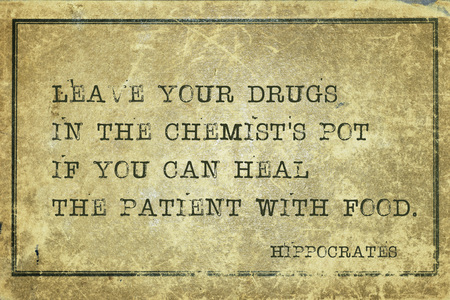 Leave your drugs in the chemists pot if you can heal the patient with food - famous ancient Greek physician Hippocrates quote printed on grunge vintage cardboard Stock Photo
