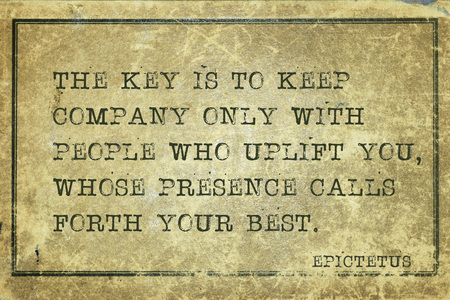The key is to keep company only with people who uplift you - ancient Greek philosopher Epictetus quote printed on grunge vintage cardboard Banco de Imagens