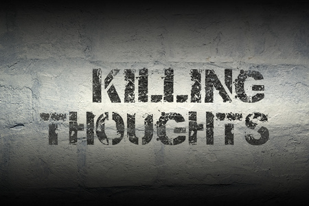 killing thoughts stencil print on the grunge white brick wall