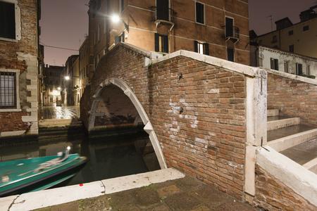 famous Ruga Vecchia bridge in Venice by night