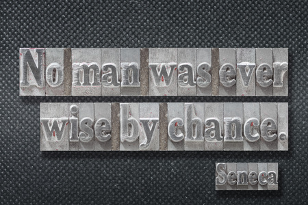 No man was ever wise by chance - ancient Roman philosopher Seneca quote made from metallic letterpress on dark background