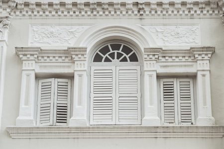 traditional Chinese building wall with closed wooden shutters