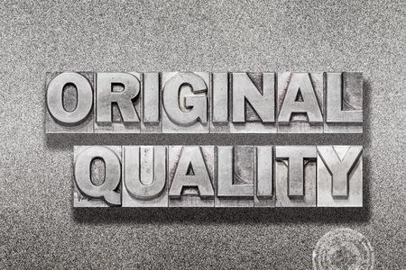 original quality phrase made from vintage letterpress on metallic textured background