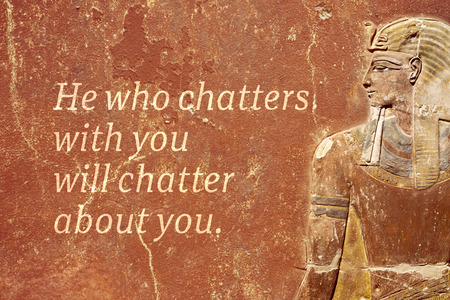 He who chatters with you will chatter about you - ancient Egyptian proverb printed on red grunge wall