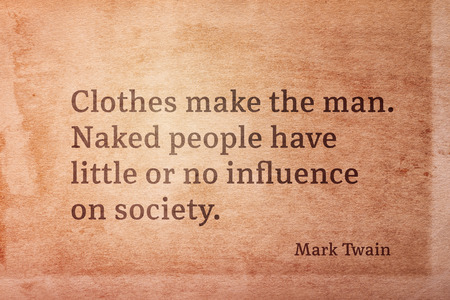 Clothes make the man - famous American writer Mark Twain quote printed on vintage grunge paper