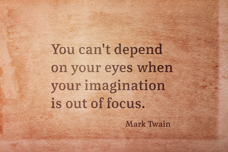 You cant depend on your eyes when your imagination is out of focus - famous American writer Mark Twain quote printed on vintage grunge paper 版權商用圖片