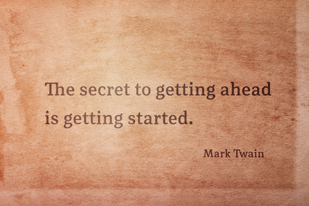 The secret to getting ahead is getting started - famous American writer Mark Twain quote printed on vintage grunge paper