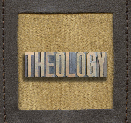 theology word made from vintage wooden letterpress inside stitched leather frame