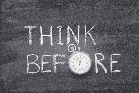 think before phrase handwritten on chalkboard with vintage precise stopwatch used instead of O Imagens