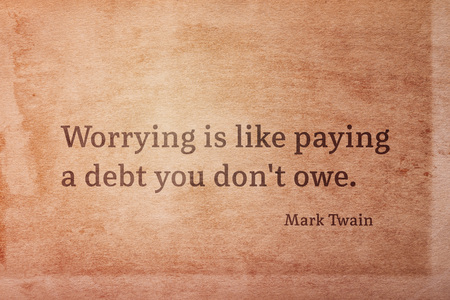 Worrying is like paying a debt you dont owe - famous American writer Mark Twain quote printed on vintage grunge paper Imagens