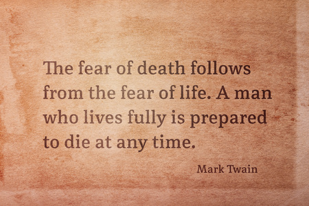 The fear of death follows from the fear of life - famous American writer Mark Twain quote printed on vintage grunge paper
