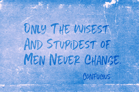 Only the wisest and stupidest of men never change - ancient Chinese philosopher Confucius quote printed on grunge blue paper Archivio Fotografico - 113766149