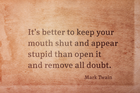 Its better to keep your mouth shut and appear stupid - famous American writer Mark Twain quote printed on vintage grunge paper