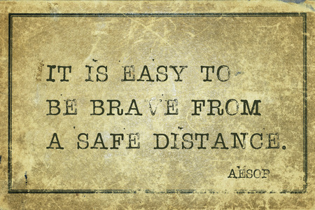 It is easy to be brave from a safe distance - famous ancient Greek story teller Aesop quote printed on grunge vintage cardboard