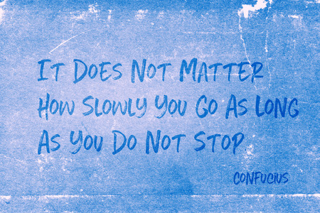 It does not matter how slowly you go as long as you do not stop - ancient Chinese philosopher Confucius quote printed on grunge blue paper