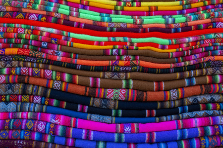 colorful ethnic background from stacked Bolivian blankets