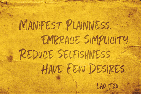 Manifest plainness, Embrace simplicity, Reduce selfishness, Have few desires - ancient Chinese philosopher Lao Tzu quote printed on grunge yellow paper Archivio Fotografico