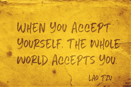 When you accept yourself, the whole world accepts you - ancient Chinese philosopher Lao Tzu quote printed on grunge yellow paper