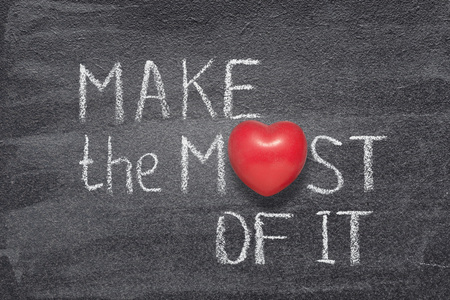 make most of it phrase handwritten on chalkboard with red heart symbol instead of O
