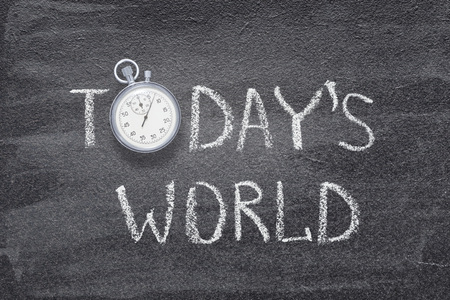 todays world phrase written on chalkboard with vintage stopwatch used instead of O 版權商用圖片