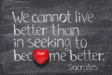 We cannot live better than in seeking to become better - quote of ancient Greek philosopher Socrates written on chalkboard with red heart symbol instead of O Banco de Imagens